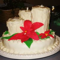 Pointsettia Cake Fruit cake base with MMF. Candles are gingerbread cake with creamcheese icing. Pointsettia and holly leaves are MMF