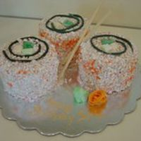 California Roll  Sushi - California Roll - made with buttercream cakes and rice krispees (shaken -not stirred, in confectioner's sugar and orange sugar...