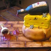 Spilled Wine Housewarming Cake I made this for a housewarming party. Everything is edible. I used RKT for the bottle for the first time and have a lot to learn!! Overall...