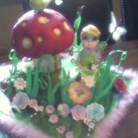 Tinkerbell's Garden Cake This is a cake I made for a client's daughter's 2nd birthday. Sprry for the quality of the picture. I lost my camera and had to...