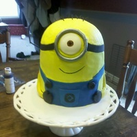 Despicable Me Minion Buttercream head, fondant arms, overalls, and accessories. Thanks for looking!