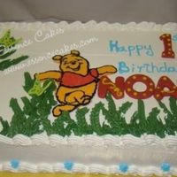 Winnie-The-Pooh Vanilla cake filled and frosted with buttercream.