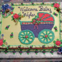 Welcome Baby Wyler This cake for a baby shower for a girl at church. I did the baby buggie with butter cream icing stared in, the clip art was from the...