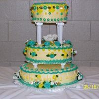 50Th Anniversary Cake This is my first 3-tiered cake that I delivered. I used all buttercream icing. Made a lot of flowers 10 days in advance. I had a lot of...