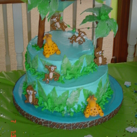Amanda And Andy's Shower Cake Safari themed shower cake made to kinda match the invitations, wanted to include giraffes and monkeys. Mom was happy.