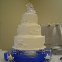 Nichole's Wedding Cake Simple 3 layer wedding cake covered with fondant and royal icing snowflakes