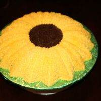 Sunflower_And_Gift_Cake_002.jpg Gift I made for a friend. The sunflower was her Mother's favorite flower.
