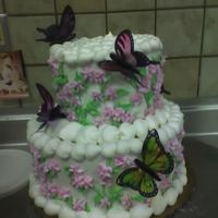 Butterfly Wedding Cake stacked wedding cake with buttercream icing. client was so thrilled that she bought up the extra butterflies i had so the bridesmaids could...