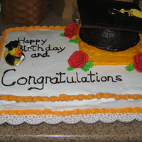 High School Graduation Cap sheet cake yellow with buttercream, hat is chocolate with ch. buttercream made with half of a ball mold, lid is cardboard cover with icing...