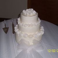 Retro Roses Wedding Cake This was my first wedding cake...roses are made from fondant...bottom 10 in is french Vanilla, middle 8 in is lemon, top 6 in is almond......
