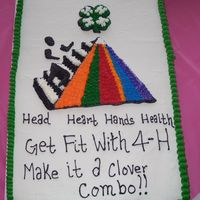 4-H Cake Cake made for our 4-H awards banquet. Art work on cake is based off of the art for the years 4-h focus.Im up for suggestions on this cake...
