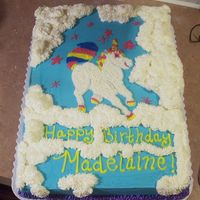 Unicorn In Clouds This cake was done for my niece for her 9th birthday. She loves horses and unicorns and everything fairytale. This is a 1/2 sheet cake done...