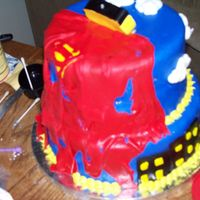 Superman Cake For My Nephew's 4Th Birthday Party Just a view of the back of the cake. The cape is rippied and supposed to look like Superman was in a battle or something... lol...