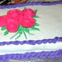 Practice Roses Cake This cake was to be a practice cake for the soccer cake. I attempted to move the 12 x 18 cake and it fell apart. I was able to save part of...
