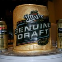 Miller Genuine Draft I made this cake for my Husband's birthday. MGD is his drink of choice. This was a lot of first. First time using MMF, edible transfer...