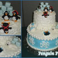 Penguin Party! Cake I made for our family white elephant party. (This is why there is an elephant in the artic!) Buttercream frosting with fondant accents...
