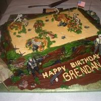 Gijoe_Camo_Cake This is my version of a GiJoe Camo Novelty Cake. i normally do not use toys on my cake, but what can you say to an adorable 8-yr old boy...