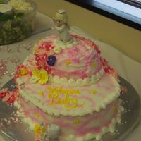 Baby Angel Sorry for the poor lighting on this pic. This cake was iced with buttercream and was airbrushed using a cloud technique. The borders were...