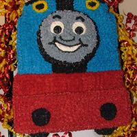 Thomas The Train I made this cake for my son a couple of years ago...I got the template online! Buttercream frosting. I used graham crackers for the red...