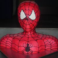 Spiderman Bust Cake my version of the spiderman bust cake. all buttercream. very difficult to get the icing a bright red color. can't wait until I can get...
