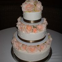 Buttercream Wedding Cake  My first (and probably last, too stressful :/ ) wedding cake. White cake with buttercream dream. Silk flowers. It had a few flaws but...