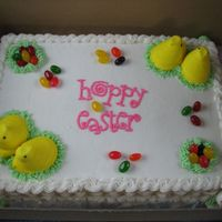 Hoppy Easter   white cake with BC icing, peeps, jelly beans and malted milk eggs. writing is color flow.