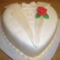 Heart Shaped Tuxedo Cake this was the tuxedo cake i did with the dress cake. thank you boween for your inspiration. everything is fondant except the rose (took me a...