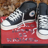 Converse Chuck Taylor's In Cake  first carved shoe cake..I made this using Nati's tutorial http://www.how2cakes.com/converse.html and I was pretty happy with the way...