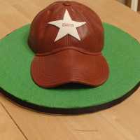Baseball Cap Cake  My work is having a charity auction tomorrow and they asked me if I would make a cake for it..I decided to do a baseball cap since it'...