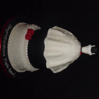 Wedding Shower Dress Cake  I was asked to make a dress cake for a wedding shower that had a very full skirt. The colours were white, black and a bit of red so this is...