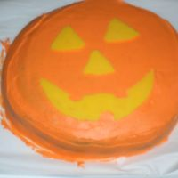 Pumpkin Cake chocolate cake with buttercream icing. The pumpkin face is made using a chocolate transfer