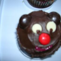Teddy Bear Cupcakes Chocolate cupcakes with chocolate frosting. Ears are Junior mints. Eyes are white chocolate chips with the eyes piped in using chocolate BC...