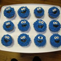 Cookie Monster Cupcakes  yellow cake with buttercream. Eyes are made of marshmellows. I used tip 233 to get the fur like appearance. Blue colour was made using a...