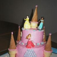 "Princess Castle Cake 8"" and 6"" double layer chocolate cake, with pink BC. Ice Cream Cone Turrets, Royal Icing Flowers, Candy Decorations and Princess..."