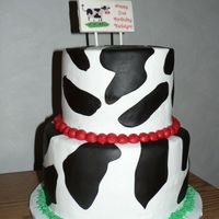 "Farm Cow Cake  6"" and 8"" yellow cake with buttercream filling and frosting. Cow print made from chocolate fondant tinted in black. Sign made of..."
