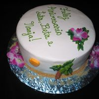 Tropical Birthday   Pina Colada cake with pineapple filling frosted in buttercream. Sand made of cookie crumbs. Yes I cheated and used fake flowers.