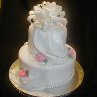"Classic Wedding 6"" & 10"" yellow cake with buttercream filling. Crumbcoated in buttercream and covered in fondant."