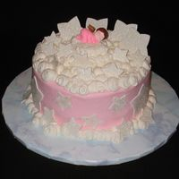 Welcome Angel White Chocolate cake filled with raspberry filling and frosted with buttercream. Stars are fondant with cake glitter.