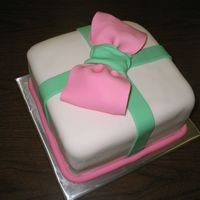The Present   Yellow cake with pineapple filling crumb coated in heavy buttercream and finished in fondant.
