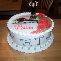Brians Graduation My nephew graduated...he is a Respitory Therapist. Very simple cake. I took a piece from scrapbooking and added for a simple touch.