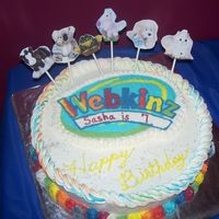 Webkinz Cake  My daughter wanted this for her 7th b-day. I did a frozen buttercream transfer for the logo and printed off pictures of the stuffed toys...