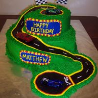 Race Track Made this for a 5yr old boy. Vanilla and Chocolate cake with bc and chocolate clay road. The mom provided the cars. I got my...