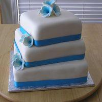 Blue Wedding Cake Well actually is was for a wedding vow renewal...but. WASC cake with MMF and gumpaste frangipani flowers airbrushed blue. I traveled 5...