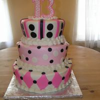13Th Birthday Cake Iced in Buttercream with MMF accents. 13 done in gumpaste with royal accents.