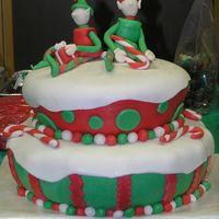 Christmas Elves MMF over buttercream. Elves molded from MMF.