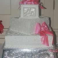 Pretty In Pink, Wedding Cake With Gumpaste Bows 3 tier square wedding cake, italian cream, chocolate with chocolate mouse filling, white with lemon filling for a friends wedding. The...
