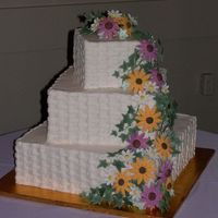 Summer Wildflower Wedding Cake Buttercream Basketweave with gumpaste Black-Eyed Susans, Coneflowers, daisies and ivy and royal icing bluebells, for a friend's late...