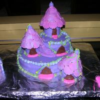 Purple Fantasy Castle  For my daughters 6th birthday. Chocolate Fudge Cake, covered with MMF, buttercream accents & dragees. The MMF was drying out on me too...