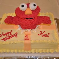 Elmo Cake I had no idea what kind of cake to do for my daughter's first birthday. She has shown a lot of interest in an Elmo doll so I decided...