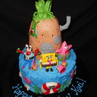 Sponge Bob Birthday Cake   I made this for my daughter's 2nd birthday - she loved it! All characters are MMF. Pineapple is RKT covered in MMF.